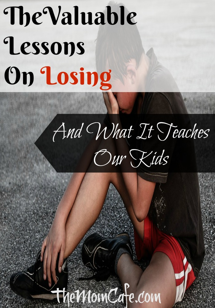 Boy on the field sitting with head in hands. The valuable lessons on losing and what it teaches our kids. #Parenting #losing #lessons