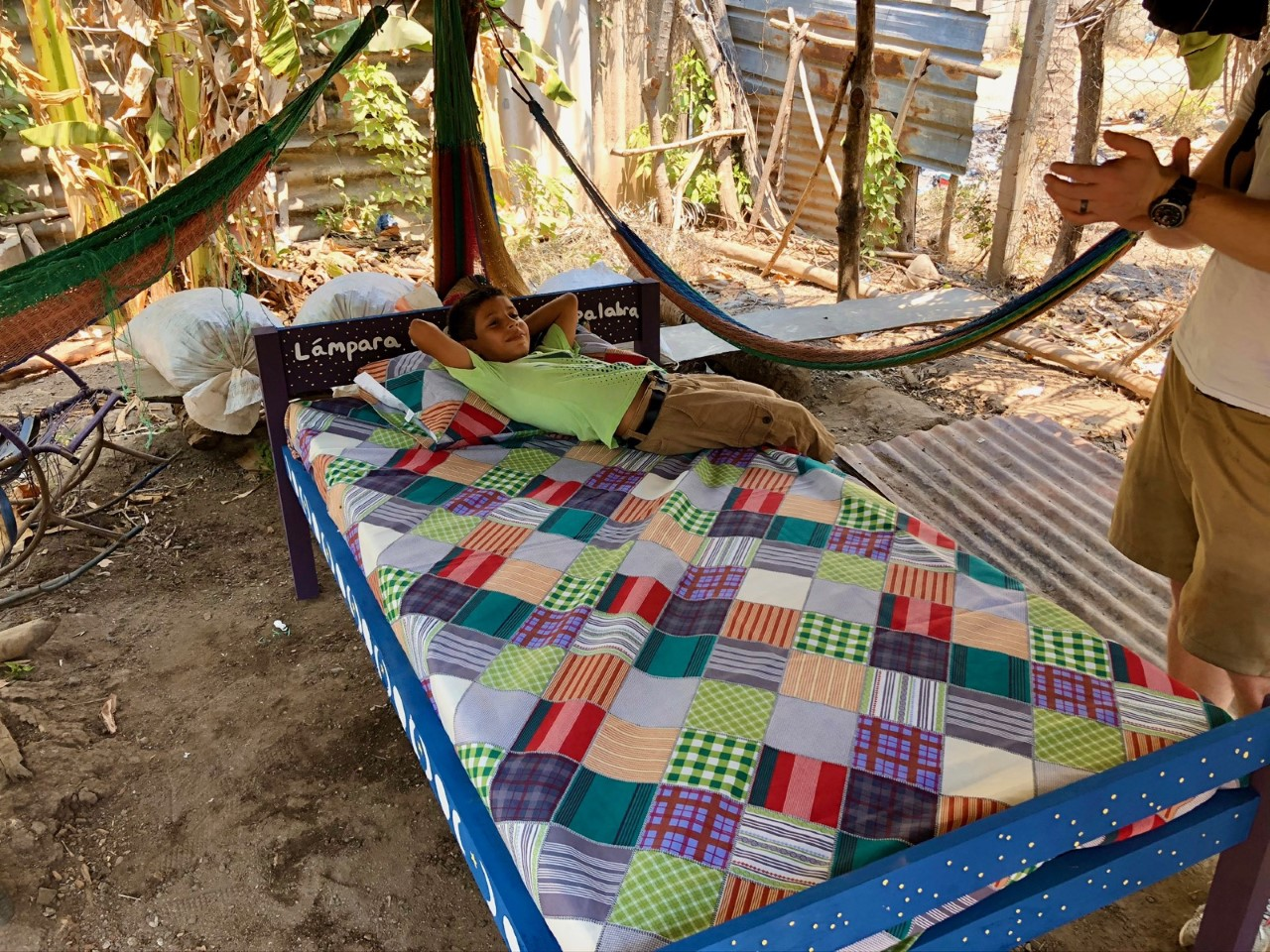 Boy's first bed in El Salvador all stuck at home